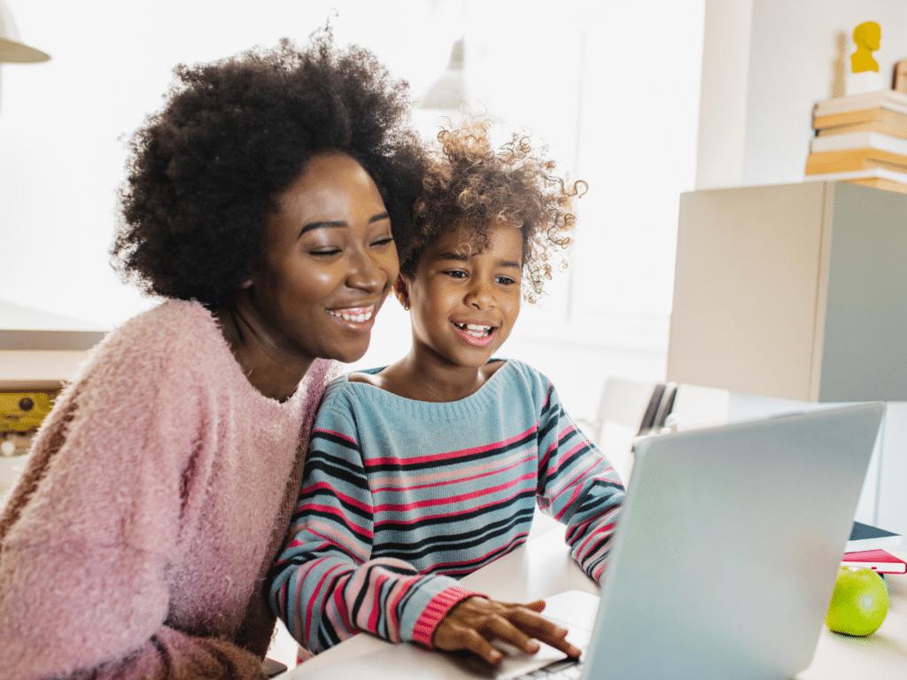 parent and child navigating through online learning platform